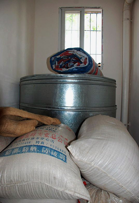 Steel granaries, provided by Amity Foundation, help keep the harvest from spoiling. A UMNS Web-only photo courtesy of Amity Foundation.