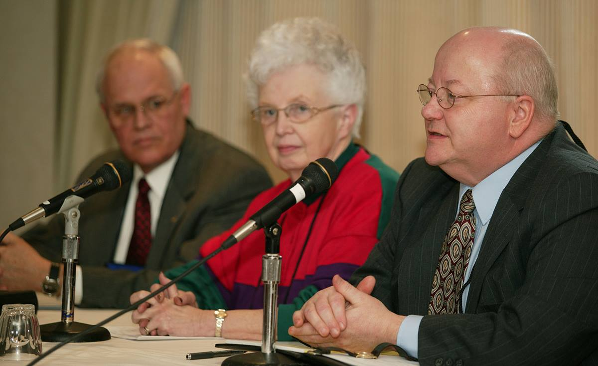 As chairperson of the Commission on the General Conference, the Rev. James Perry (right) discusses how General Conference operates. UMNS photo by Mike DuBose