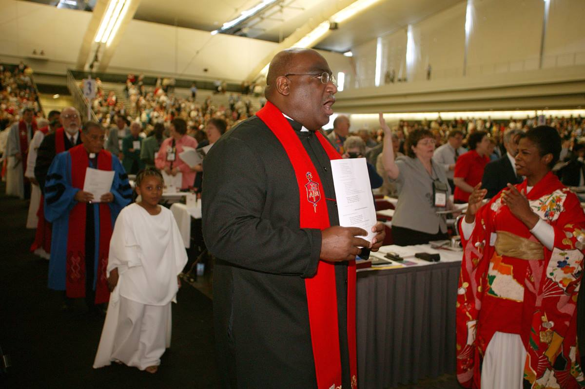 Bishop Gregory V. Palmer (center) joins the processional during the opening worship of the United Methodist Church's 2004 General Conference in Pittsburgh. The church's top legislative assembly is meeting April 27-May 7. Palmer leads the church's Iowa Area. A UMNS photo by Mike DuBo