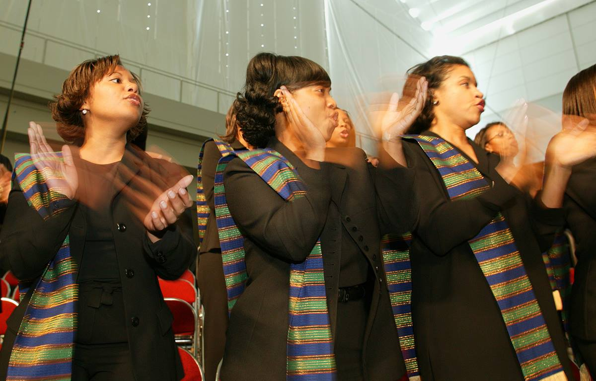 Choir members from St. James United Methodist Church, Alpharetta, Ga., sing and dance during Wednesday morning worship at the United Methodist General Conference in Pittsburgh. A UMNS photo by Mike DuBose.