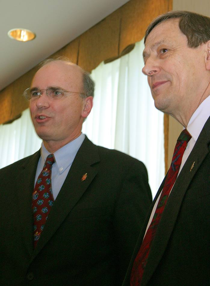 United Methodist Bishop Peter D. Weaver (left) is installed as president of the denomination's Council of Bishops, succeeding Bishop Ruediger R. Minor (right), Eurasia. The installation came during the 2004 General Conference in Pittsburgh. A UMNS photo by Rasul Welch.