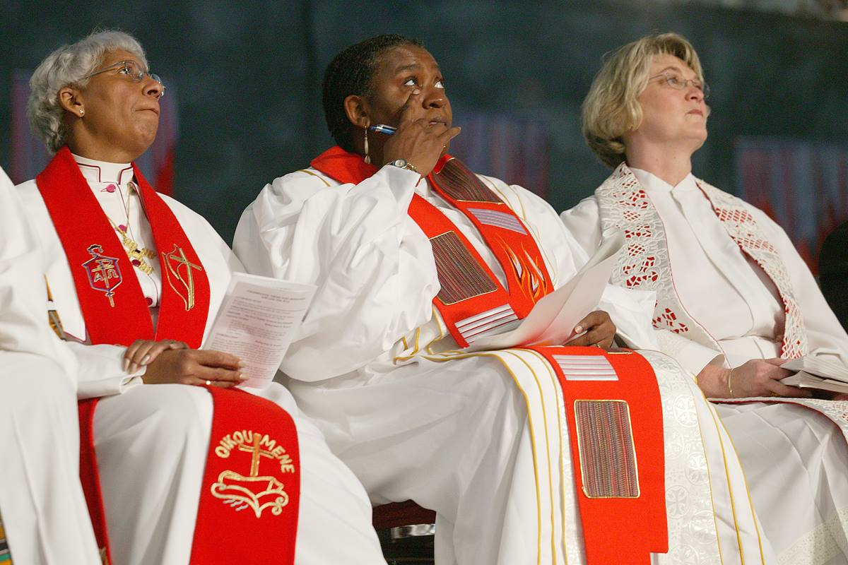 The Rev. Renita Thomas (center) wipes away a tear during a service of appreciation for African Americans who stayed in the church despite institutional racism at the United Methodist Church's 2004 General Conference in Pittsburgh. Thomas is flanked by Bishops Violet L. Fisher (left) and Charlene P. Kammerer. A UMNS photo by Mike DuBose.