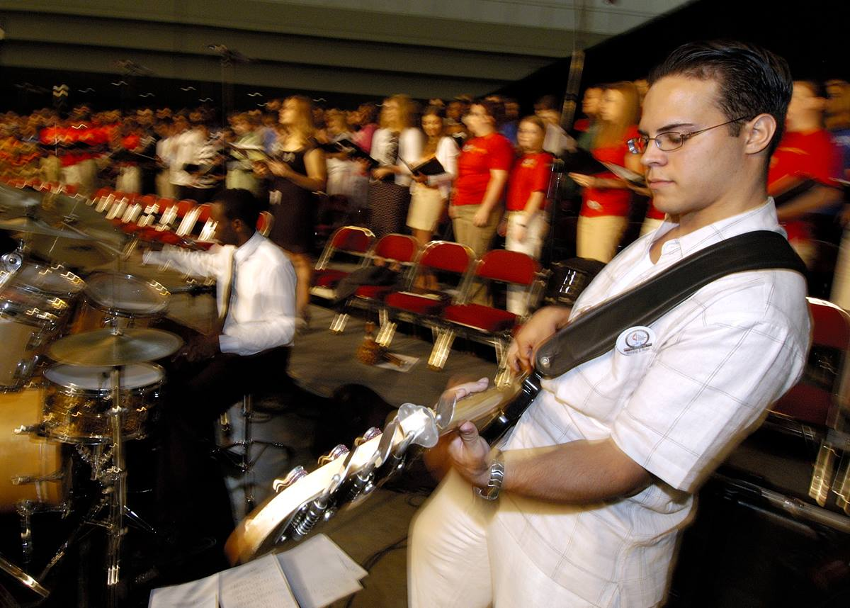 Remy Dou, a guitarist with Drive, the Miami District Youth Band, performs during morning worship on May 1 at the 2004 United Methodist General Conference in Pittsburgh. A UMNS photo by Paul Jeffrey.