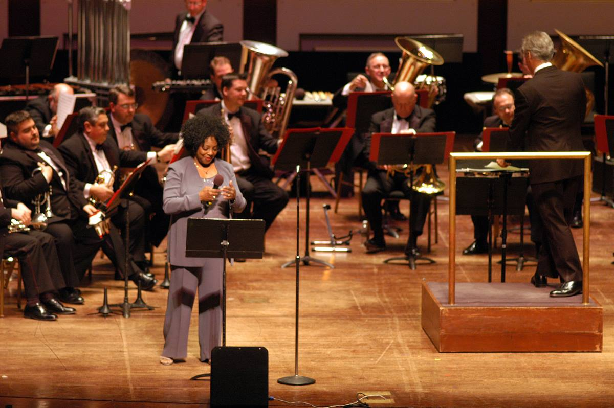 Jazz singer Etta Cox (left foreground) performs with the River City Brass Band during the Pittsburgh Area Night program at the Heinz Hall for the Performing Arts. Pittsburgh is host to the United Methodist Church's 2004 General Conference April 27 - May 7. A UMNS photo by John C. Goodwin.