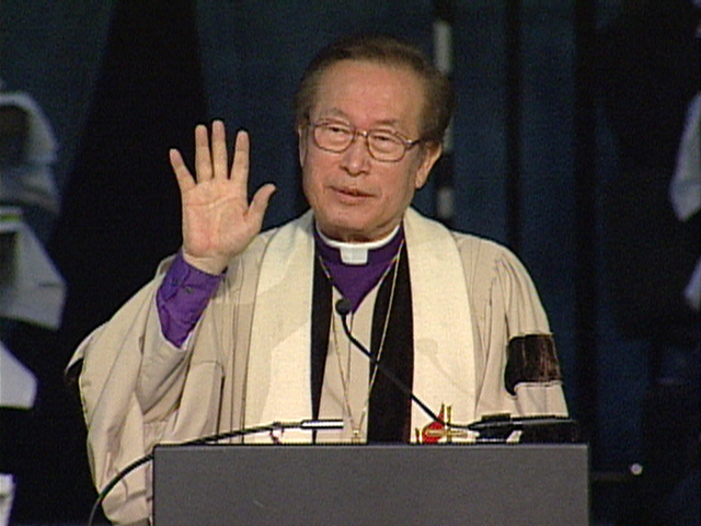Bishop Hae-Jong Kim gives the  May 3 morning message at General Conference 2004. Video still by United Methodist Communications