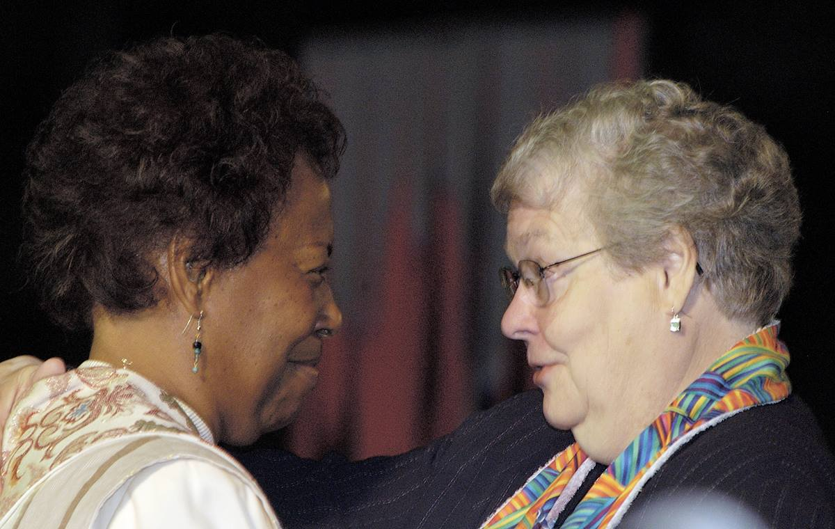 Bishop Beverly J. Shamana, San Francisco Area (left), is greeted by Bishop Judith Craig after Shamana's sermon during morning worship on May 5 during the 2004 United Methodist General Conference in Pittsburgh. A UMNS photo by Paul Jeffrey.