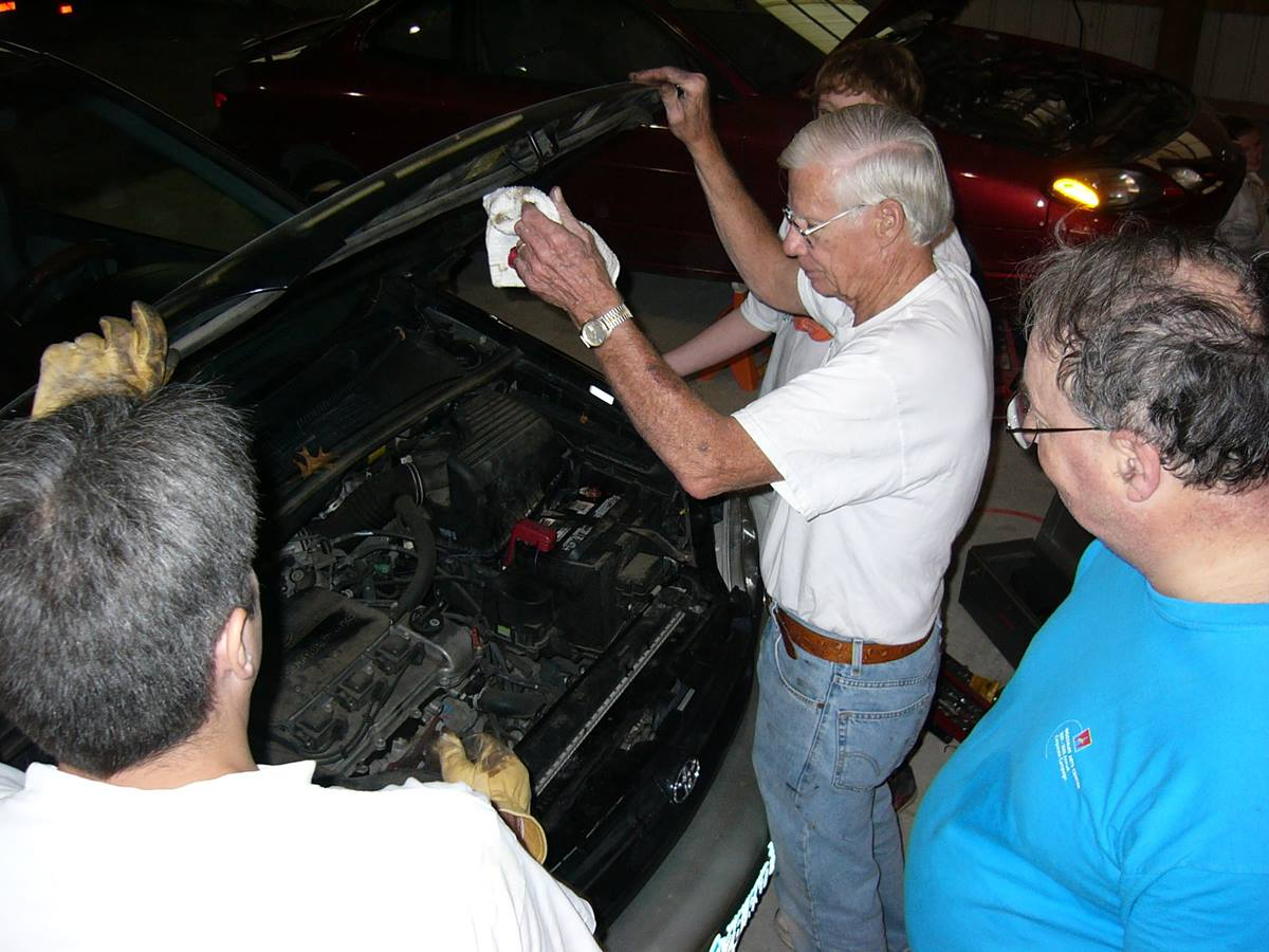 Volunteers from McEachern Memorial United Methodist Church in Powder Springs, Ga., repair cars for needy people once a month. A UMNS photo by Lyle Jackson