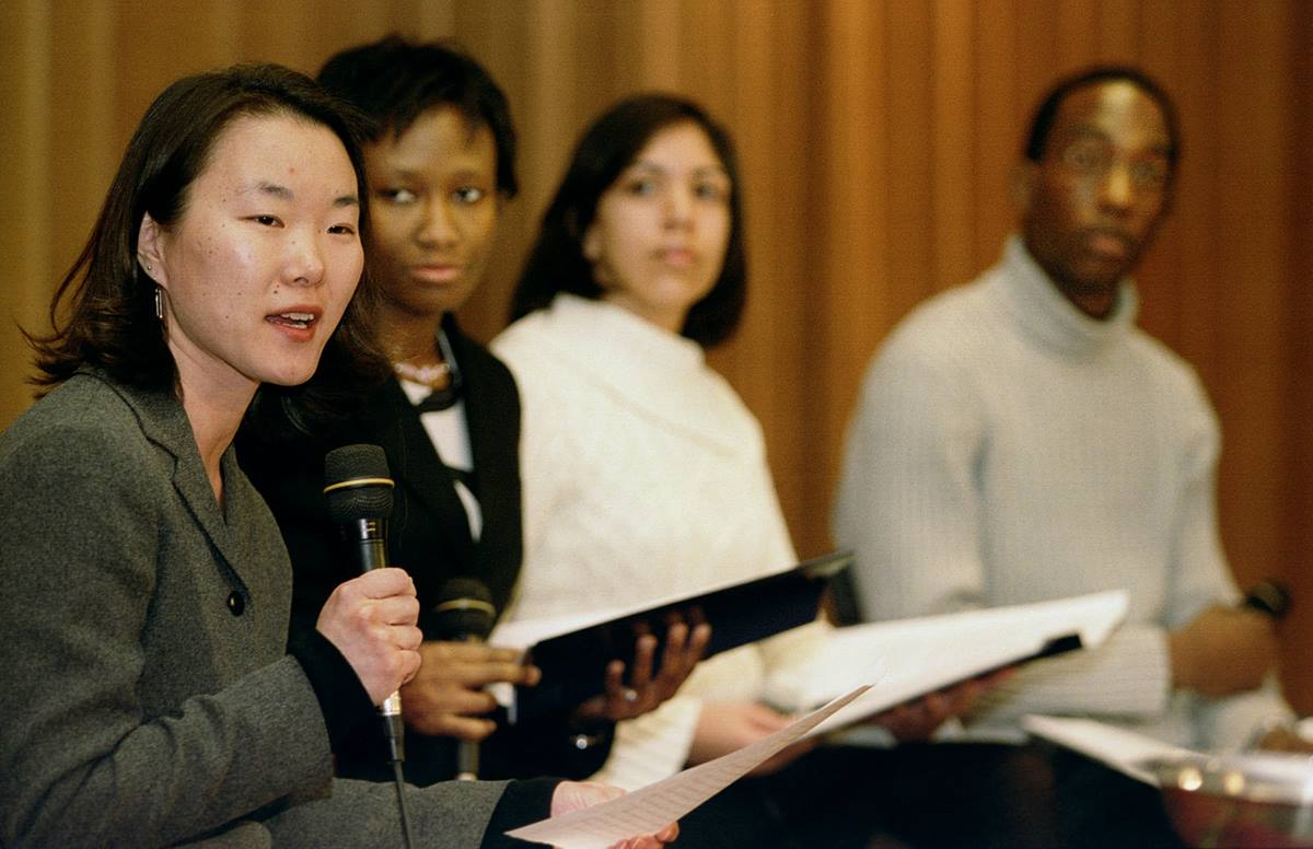 Julie O'Neal (left) talks about ministries with young people during the Pre-General Conference News Briefing Jan. 31 in Pittsburgh. UMNS photo by Mike DuBose