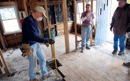 Bethel United Methodist Church site coordinator and mission volunteers from Poughkeepsie, N.Y., work inside a home damaged by Hurricane Sandy on Staten Island, N.Y. Recovery work being done by Volunteers in Mission through the New York Annual Conference, United Methodist Church. AUMNS photo by Arthur McClanahan