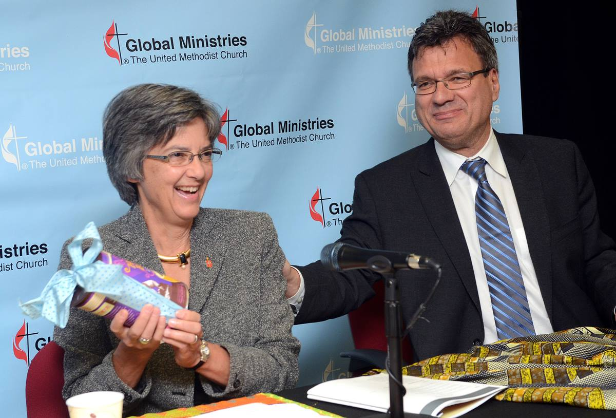 "Bishop Hope Morgan Ward, new president of the United Methodist Board of Global Ministries, receives a gift of ""Hope's Blend"" fair trade coffee from Thomas Kemper, the board's top executive. UMNS photos by Cassandra Zampini, GBGM."
