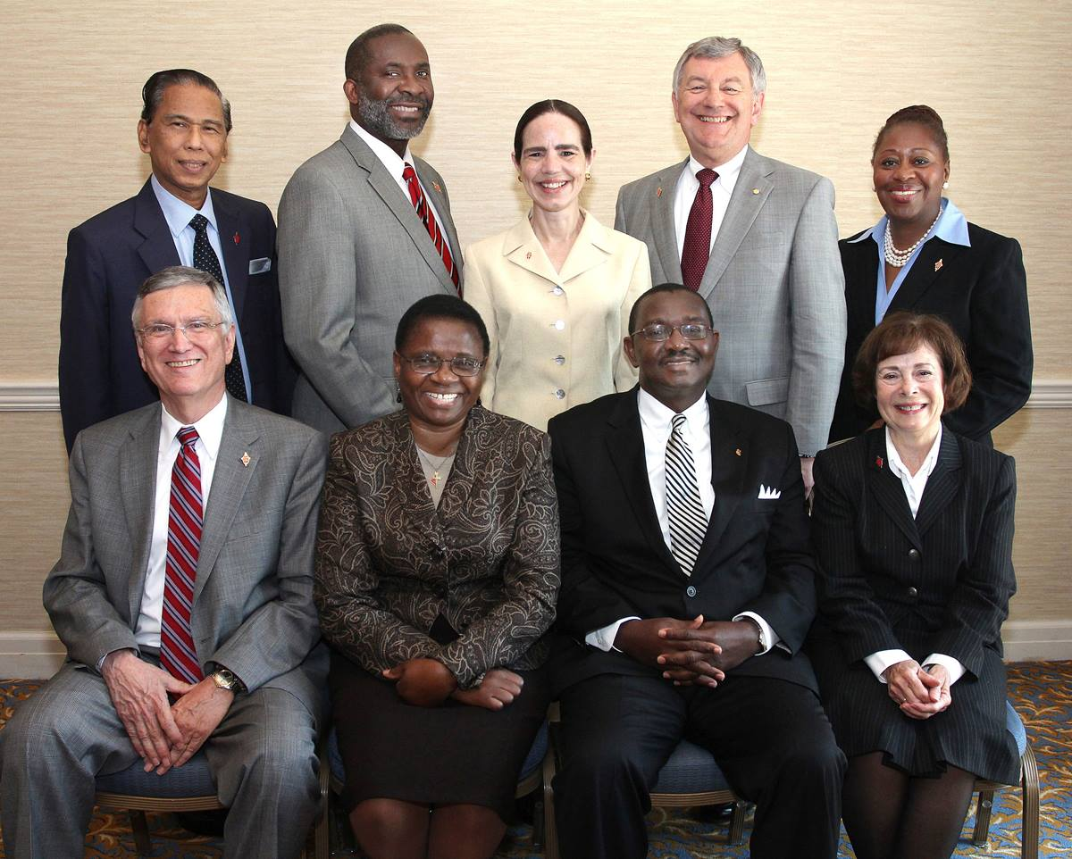 The Judicial Council for 2012-16 took up a full docket during its Oct. 24-27 session in Elk Grove Village, Ill. From left: Belton Joyner, J. Kabamba Kiboko, N. Oswald Tweh Sr., and Kathi Austin Mahle. Standing from left: Ruben T. Reyes, Dennis Blackwell, Beth Capen, William B. Lawrence and Angela Brown. A UMNS photo by Kathleen Barry.