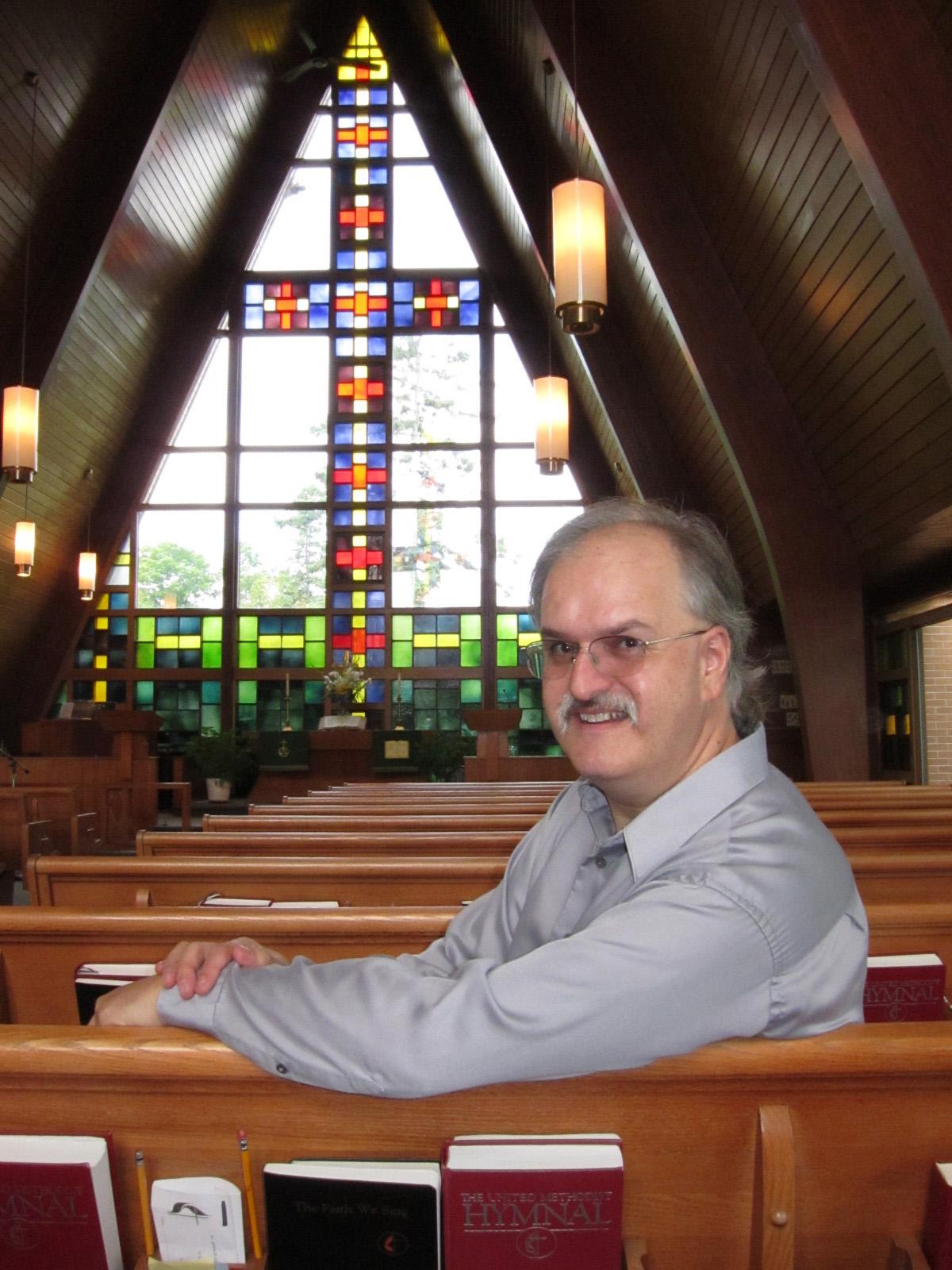 The Rev. Erik Alsgaard inside St. Ignace United Methodist Church in St. Ignace, Michigan. A UMNS photo by Kathleen Barry.