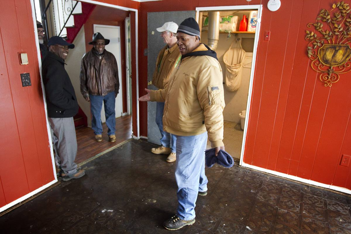 Leroy Morgan (right) provokes smiles among United Methodist Church officials and relief workers as he describes using a garden hose to remove jellyfish that were washed into his Freeport, N.Y., home by Hurricane Sandy. UMNS photos by Mike DuBose.