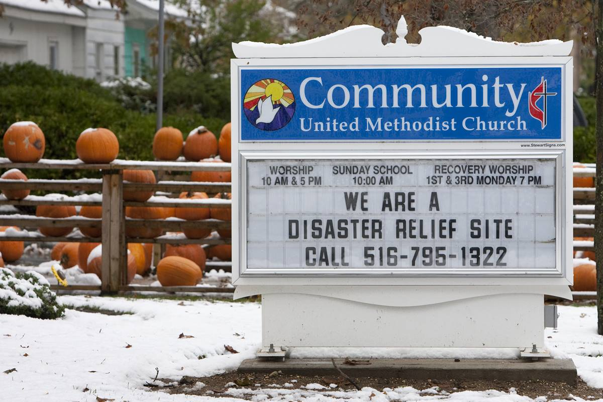Snow covers pumpkins from a fall festival at Community United Methodist Church in Massapequa, N.Y., that was interrupted by Hurricane Sandy and a subsequent noreaster snowstorm that left several inches of snow on parts of Long Island. The church is serving as a disaster relief site for survivors of the storm. A UMNS photo by Mike DuBose.