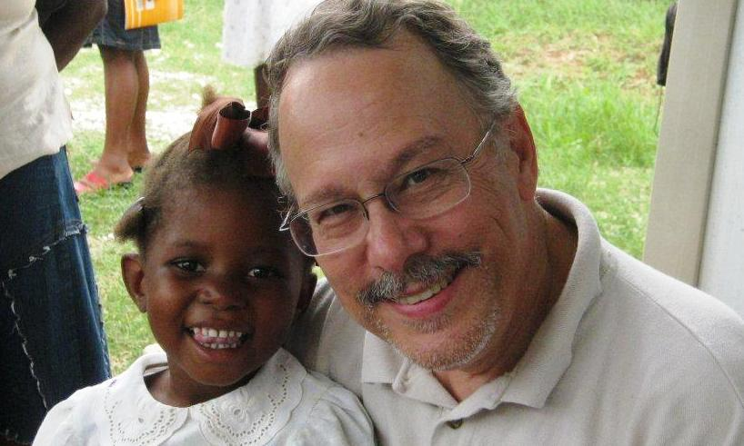 Gil Hanke and one of the 415 Haitian children tested for hearing loss, and suitability for hearing aids. Photo by Dr. Ricardo Gautier