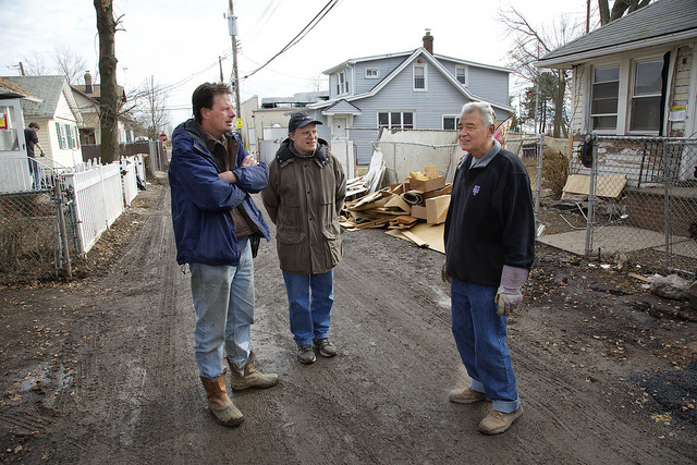Scott Mikkelson(left) and the Rev. Matt Schaeffer (center), who coordinate the church's Sandy relief work on Staten Island, talk with John Stonick, whose home was one of many damaged by the storm. Photos by Arthur McClanahan, Iowa United Methodist Conference.