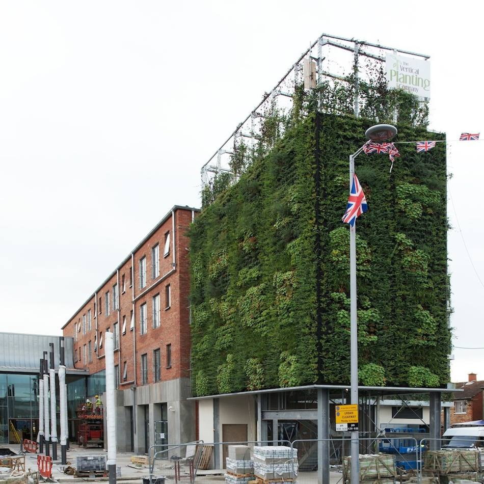 The East Belfast (UM) Mission is housed in the Skainos Center, shown here behind its vertical garden. A web-only photo courtesy of the Skainos Project.