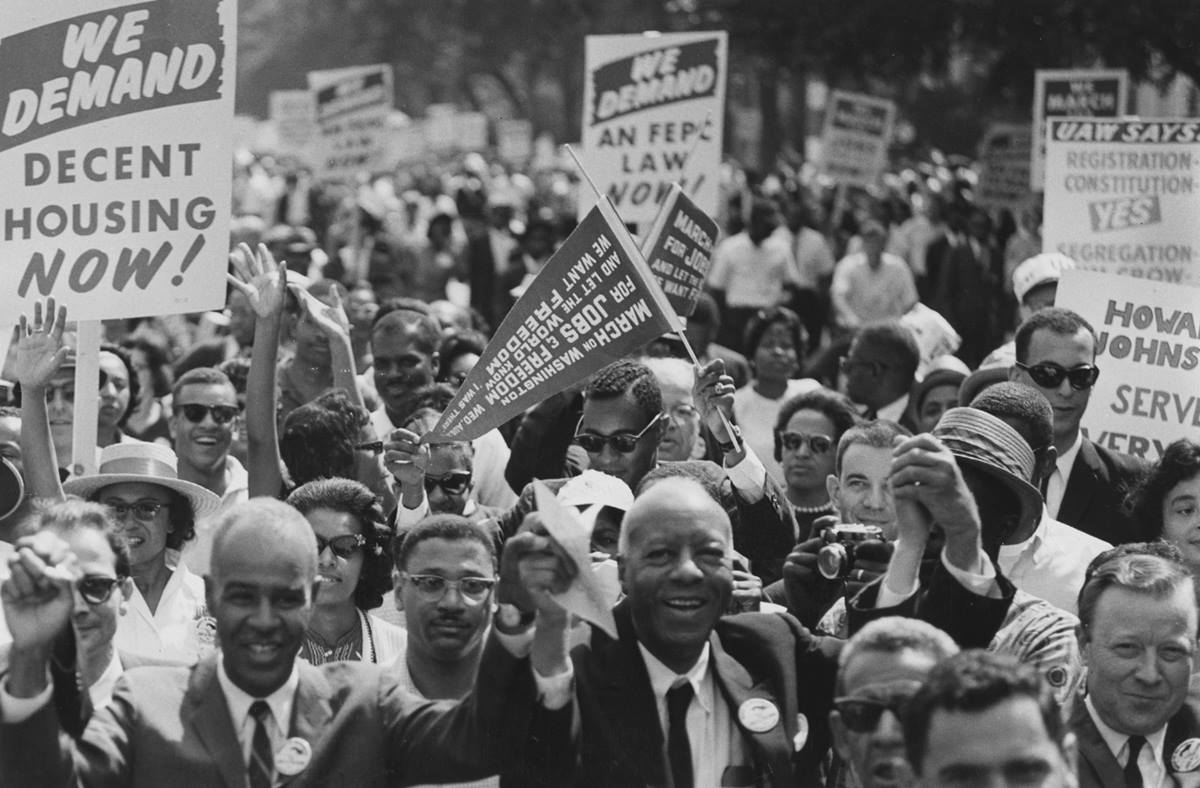 Labor organizers help lead marchers from the Washington Monument to the Lincoln Memorial on Aug.28, 1963, during the March on Washington for Jobs and Freedom. Holding hands near the front are Roy Wilkins (left), executive secretary of the National Association for the Advancement of Colored People; A. Philip Randolph (center), organizer of the demonstration; and Walter P. Reuther, president of the United Automobile Workers Union and Vice President of the American Federation of Labor and Congress of Industrial Organizations. Photo courtesy of Wikimedia Commons.