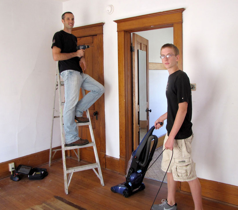 Volunteers Bryce Riemer and Joe Jackson clean and repair the day center for Family Promise of Green County. Photo by Deb Weis.