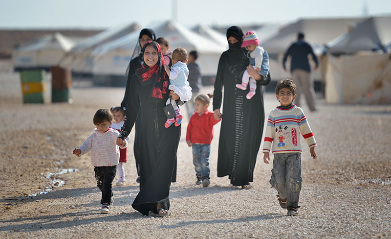 Women and children walk through the Zaatari Refugee Camp near Mafraq, Jordan. Opened in July, 2012, the camp holds more than 50,000 refugees from the civil war inside Syria. The United Methodist Committee on Relief has worked with its partners to assist the refugees. Other United Methodists are urging negotiations instead of a U.S. military attack on Syria. Photo © Paul Jeffrey, ACT Alliance.