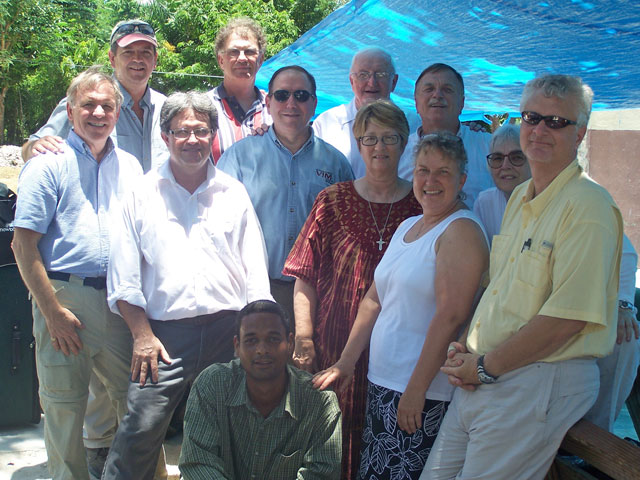 A volunteer team of United Methodists, led by Greg Forrester (top left), and a Haitian interpreter worked May 10-17 in Mellier, Haiti.
