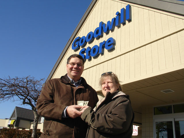Ed Metzler and his wife, Erma distributed $50 worth of $1 and $5 bills Dec. 21 at a Goodwill Store as part of a Christmas outreach. Photo by Dan Gangler, Indiana Annual Conference