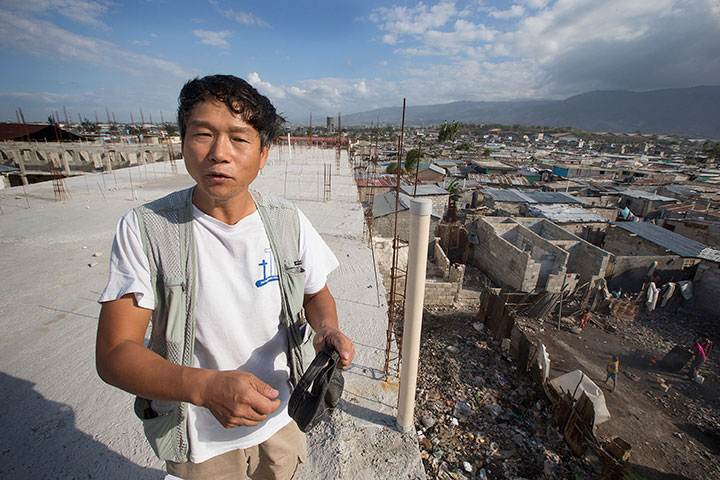 Seung Don Kim stands atop the mission center in Cité Soleil.