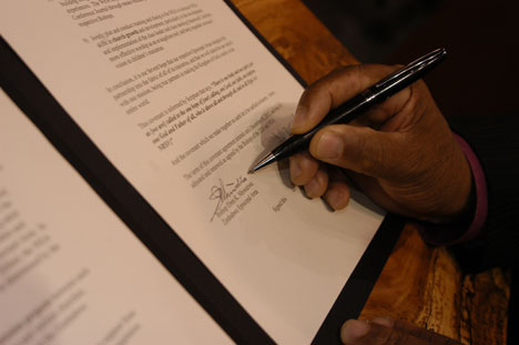 Bishop Eben K. Nhiwatiwa of the church's Zimbabwe Area signs a covenant to extend through 2012 the partnership between the Zimbabwe and Baltimore-Washington conferences. The signing ceremony occurred April 30 during the 2008 United Methodist General Conference.