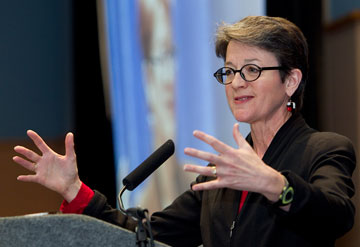 United Methodist Bishop Sally Dyck speaks about the importance of holy conversation during the pre-General Conference news briefing at the Tampa Convention Center in Florida. A UMNS photo by Mike DuBose.