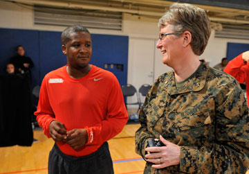 Cmdr. Laura Bender, chaplain of the Marines' Wounded Warrior Regiment, talks to members of the regiment's team in the Pentagon gym. A UMNS photo by Jay Mallin.