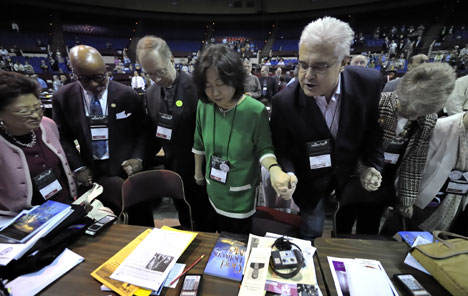 Members of the New York Annual (regional) Conference pray together before the beginning of the April 27 session of the 2008 United Methodist General Conference.