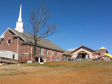 Two years after a tornado tore the steeple from Ford's Chapel United Methodist Church, Harvest, Ala., a new steeple beckons worshippers. A web-only UMNS photo by the Rev. Calvin Havens.