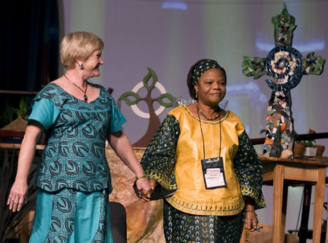 Marilyn Griffith of St. Luke's United Methodist Church in Indianapolis dances with Janet Yema Bio, a midwife at the United Methodist-related Kissy Hospital in Sierra Leone, during a presentation on The Advance, a program of designated giving through The United Methodist Church.