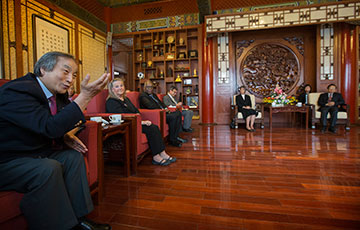 United Methodist Bishop Hee-Soo Jung (left) takes part in a discussion between members of a delegation of United Methodist church leaders and representatives of the Chinese State Administration for Religious Affairs at the administration's offices in Beijing, China. At right is Jiang Jianyong, vice minister of foreign affairs and Christianity for the administration. He is seated with Bishop Hope Morgan Ward and a translator.