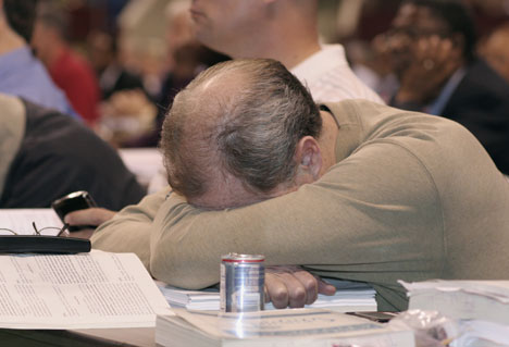 A delegate catches a quick nap in between presentations on the eighth day of the 10-day 2008 United Methodist General Conference in Fort Worth, Texas.