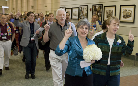 Susan Laurie (left) and Julie Bruno lead a procession through the Fort Worth Convention Center, site of the 2008 United Methodist General Conference, on the way to their marriage ceremony across the street in General Worth Square.