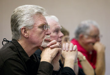 The Rev. Jim DuFriend (left) and fellow chaplains listen intently to a presentation during the United Methodist Convocation for Police, Fire and Crisis Responder Chaplains at the Scarritt Bennett Center in Nashville, Tenn.
