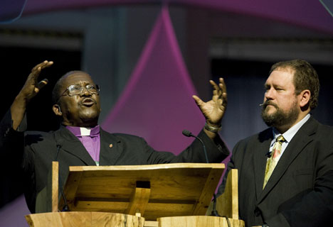 Bishop João Somane Machado of Mozambique (left) preaches during morning worship on April 25 at the United Methodist General Conference in Fort Worth, Texas. Translating is Donald Reasoner of the church's Board of Global Ministries.