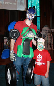 Jonatron, also known as the Rev. Jonathan Hart, stands with a little Transformer from Florida's Shalimar United Methodist Church vacation Bible school. The theme was