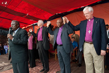 United Methodist Bishop Nkulu Ntambo (front) leads the closing prayer after an assembly in observance of the 2010 World Malaria Day in Kamina, Democratic Republic of the Congo. A UMNS photo by Lynne Dobson.