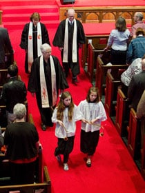 Clergy follow the acolytes out of the sanctuary after worship. Bishop Debra Wallace-Padgett, who gave the sermon, is at left rear. She is flanked by the Revs. Bob Alford (right) and Jeri Hunt.
