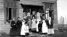 Women and children stand at the steps  of the Ottilie Simons Children's Home in Handrovo, Russia. A UMNS photo courtesy of the United Methodist Commission  on Archives and History.