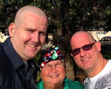 (From left) Clark and Tom Christmas shave their heads in support of Jo Christmas (center) during her chemotherapy.
