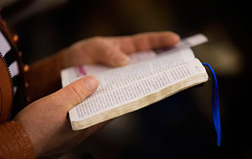 A parishioner reads her Bible at Chongwenmen Church in Beijing, China. Chinese Bible production, which was halted during the Cultural Revolution, began again in the 1980s with a prototype taken from old Bibles that had not been confiscated by the Red Guards.