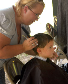 A little boy receives a haircut as part of back-to-school activities at Wesley Memorial United Methodist Church in Pace, Fla. A 2002 file photo courtesy of Wesley Memorial United Methodist Church.