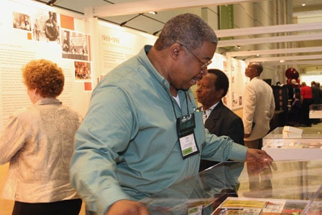 John Coleman of the United Methodist Commission of Religion and Race makes last- minute adjustments to the agency's Journey to Inclusiveness exhibit at the 2008 General Conference in Fort Worth, Texas.