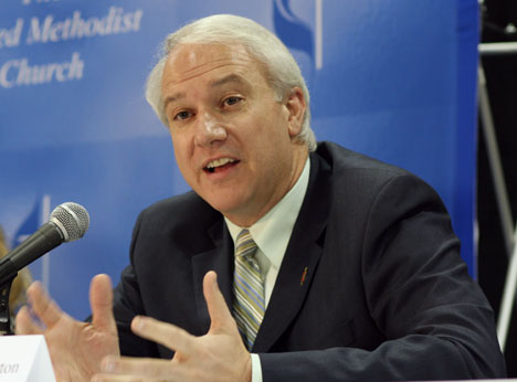 Bishop Thomas Bickerton answers questions at a press conference about the church's global health plan adopted by the 2008 United Methodist General Conference during its legislative meeting in Fort Worth, Texas.