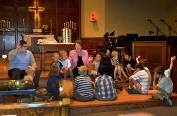 The Rev. Kathy Hartgraves instructs the children during the Aug. 4 worship at First United Methodist Church in Mitchell, S.D. Photo courtesy of the Dakotas Conference.