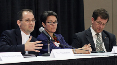 The Rev. Troy Plummer of the Reconciling Ministries Network speaks at a press conference after a time of witness on the floor of the 2008 United Methodist General Conference. Bishops Sally Dyck and Scott Jones also participate