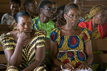 Women listen to a public health education lesson on AIDS at Jerusalem Parish United Methodist Church in Yamoussoukro, Côte d'Ivoire, in November 2008.